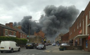 Smoke from a factory fire in Derbyshire which is scattering asbestos fibres across the town